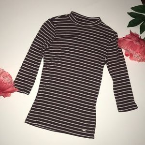 Stripped mock neck top